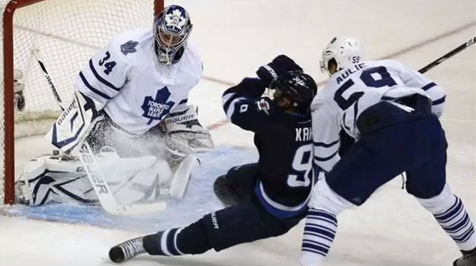 Here, the invisible hand of a hockey god can (not) be seen sweeping Evander Kane's legs from under him.