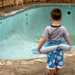 boy-at-empty-pool